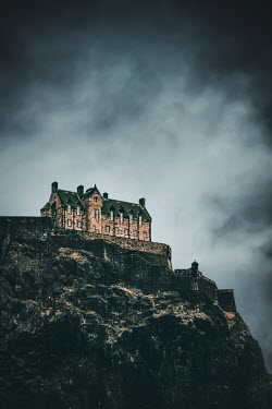 Evelina Kremsdorf HISTORICAL BUILDING ON CLIFF WITH STORMY SKY
