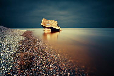 David Keochkerian WRECK OF BUNKER IN SEA WITH PEBBLE BEACH