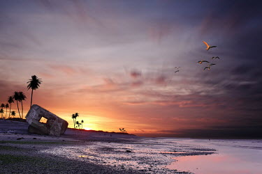 David Keochkerian DERELICT WARTIME BUNKER ON BEACH AT SUNSET