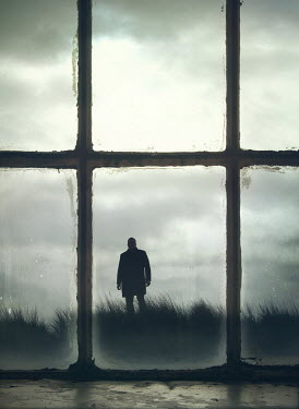 Mark Owen SILHOUETTED MAN IN COAT STANDING IN FIELD