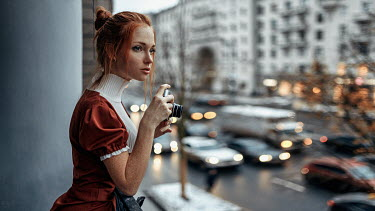 Georgy Chernyadyev GIRL WITH CAMERA WATCHING TRAFFIC IN CITY