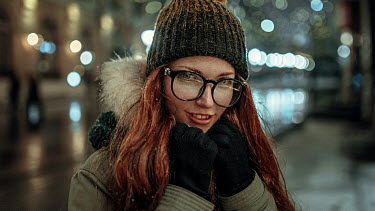 Georgy Chernyadyev SMILING WOMAN WITH RED HAIR IN CITY AT DUSK