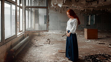 Georgy Chernyadyev WOMAN WITH RED HAIR STANDING IN DERELICT BUILDING