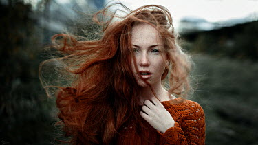 Georgy Chernyadyev WOMAN WITH LONG RED HAIR BLOWING IN WIND