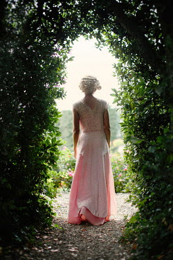 Nikaa 1930S WOMAN IN SILK GOWN WALKING IN GARDEN