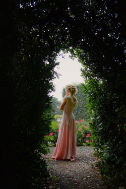 Nikaa 1930S WOMAN IN SILK GOWN STANDING IN GARDEN