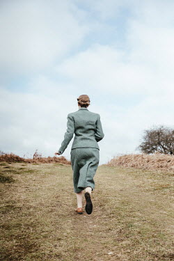 Matilda Delves RETRO WOMAN RUNNING IN COUNTRYSIDE