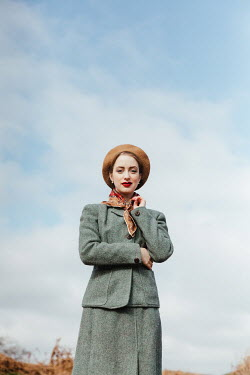 Matilda Delves RETRO WOMAN IN SUIT AND HAT OUTDOORS
