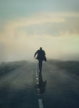 Mark Owen SILHOUETTED MAN RUNNING ON COUNTRY ROAD