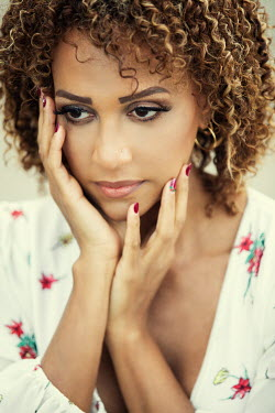 Mohamad Itani CLOSE UP OF SERIOUS WOMAN WITH CURLY HAIR