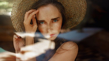 Georgy Chernyadyev GIRL WITH FRECKLES AND STRAW HAT INDOORS