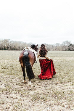 Matilda Delves HISTORICAL WOMAN WALKING IN FIELD WITH HORSE