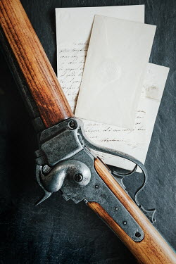 Matilda Delves ANTIQUE RIFLE LYING ON LETTERS