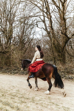 Matilda Delves HISTORICAL WOMAN RIDING HORSE IN COUNTRYSIDE