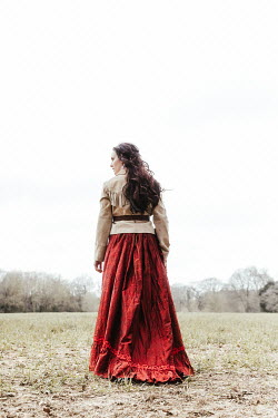 Matilda Delves HISTORICAL AMERICAN WOMAN STANDING IN COUNTRYSIDE