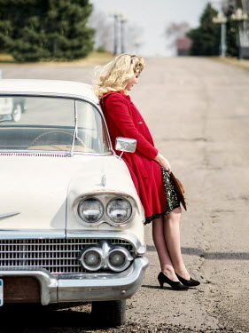 Elisabeth Ansley BLONDE RETRO WOMAN LEANING AGAINST CAR