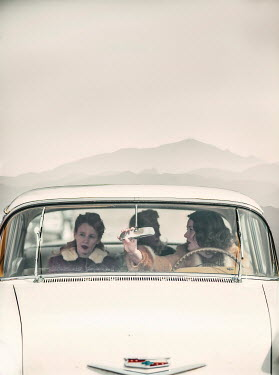 Elisabeth Ansley THREE RETRO WOMEN TRAVELLING IN CAR