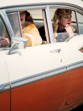 Elisabeth Ansley TWO RETRO WOMEN SITTING IN CAR
