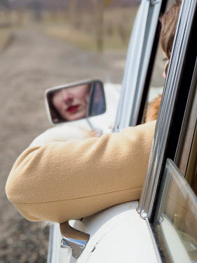 Elisabeth Ansley RETRO WOMAN REFLECTED IN CAR MIRROR