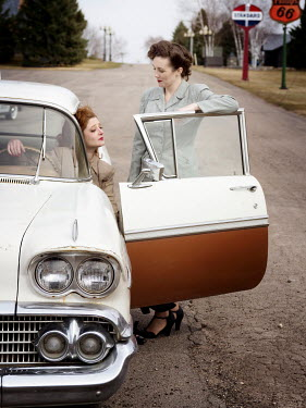 Elisabeth Ansley TWO AMERICAN RETRO WOMEN WITH CAR