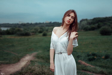 Georgy Chernyadyev BRUNETTE WOMAN IN WHITE DRESS IN COUNTRYSIDE