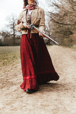 Matilda Delves HISTORICAL WOMAN WALKING WITH RIFLE IN COUNTRYSIDE