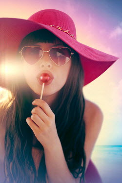 ILINA SIMEONOVA WOMAN IN HAT LICKING LOLLIPOP OUTDOORS