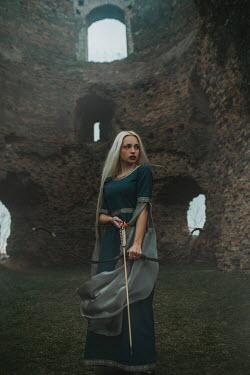 Jovana Rikalo MEDIEVAL WOMAN WITH BOW AND ARROW IN CASTLE