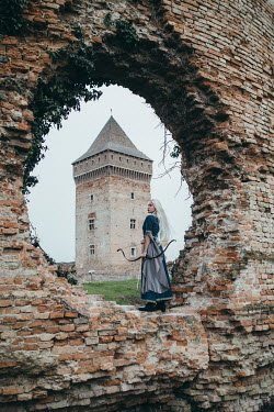 Jovana Rikalo MEDIEVAL WOMAN WITH BOW AND ARROW BY TOWER