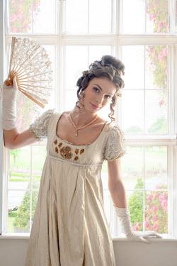 Lee Avison regency woman at the window holding a fan