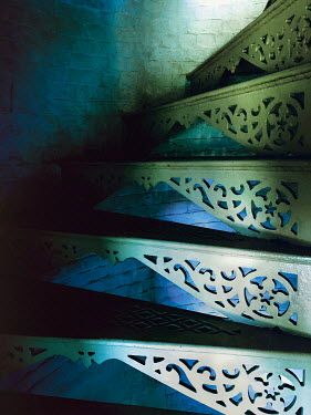 Lisa Bonowicz WROUGHT IRON STEPS IN SHADOW INDOORS