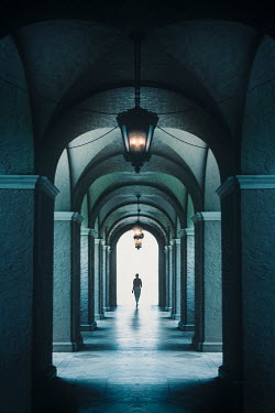 Evelina Kremsdorf DISTANT WOMAN WALKING IN ARCHED CORRIDOR