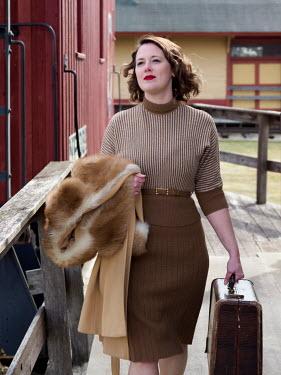 Elisabeth Ansley 1940s woman at train station
