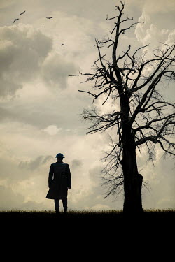 Magdalena Russocka wartime soldier standing by bare tree in field