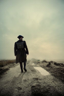 Magdalena Russocka wartime soldier walking on country road