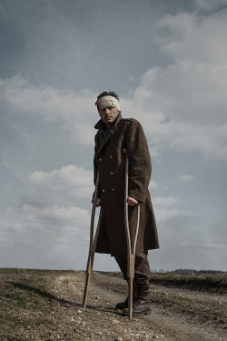 Magdalena Russocka wounded wartime soldier with crutches standing in field