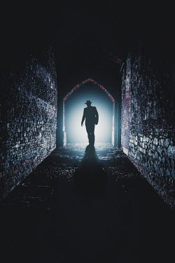 Nic Skerten Silhouette of man in tunnel