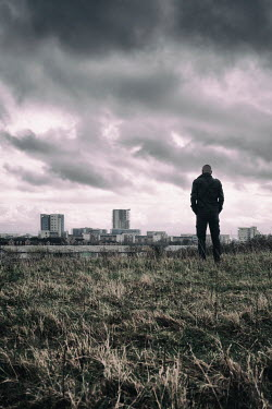 Tim Robinson Man standing in field by city