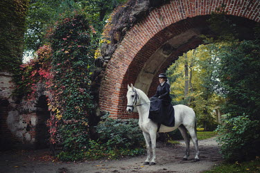 Anna Sychowicz Victorian woman on horse under bridge