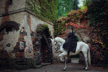 Anna Sychowicz Victorian woman on horse by abandoned building