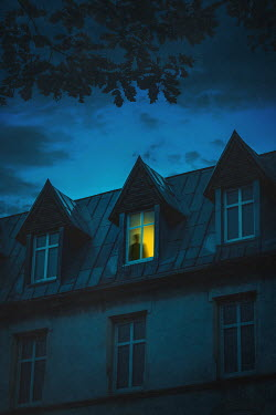 Joanna Czogala Silhouette of man in window at night