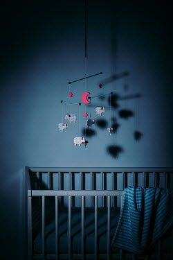 Magdalena Russocka baby cot and carousel toy at night