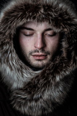 Magdalena Russocka close up of young man in fur hood