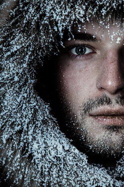 Magdalena Russocka close up of young man in fur hood covered with snow