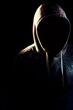 Magdalena Russocka close up of hooded man in shadow inside