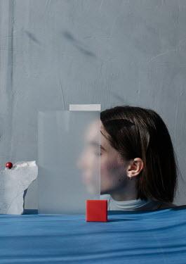 Marta Syrko Young woman behind sculpture