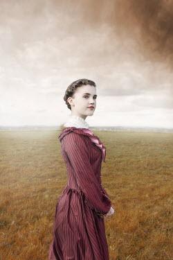 Anna Buczek HISTORICAL GIRL STANDING IN COUNTRYSIDE