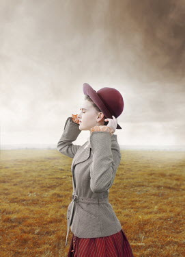 Anna Buczek HISTORICAL GIRL WITH HAT STANDING IN COUNTRYSIDE