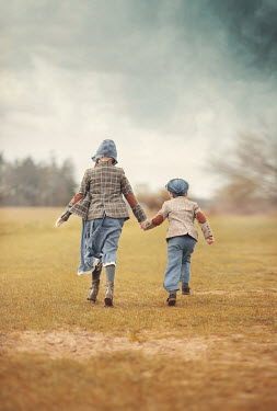Anna Buczek RETRO GIRL AND BOY HOLDING HANDS IN COUNTRYSIDE