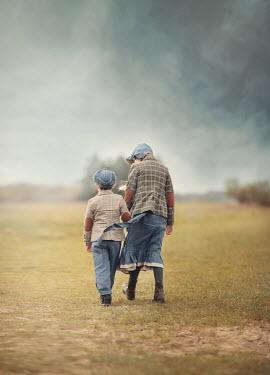 Anna Buczek RETRO GIRL AND BOY WALKING IN COUNTRYSIDE